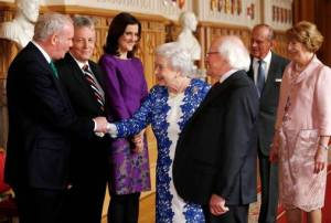 Martin McGuinness meeting his pal the British 'queen' at Windsor Castle in April 2014; he also took part in a toast to her at the banquet